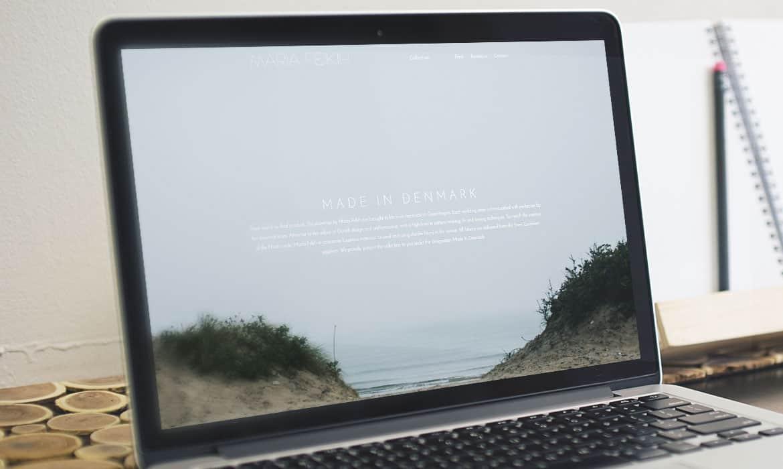 Made In Denmark sektionen fra Maria Fekihs website vist på en skærm.